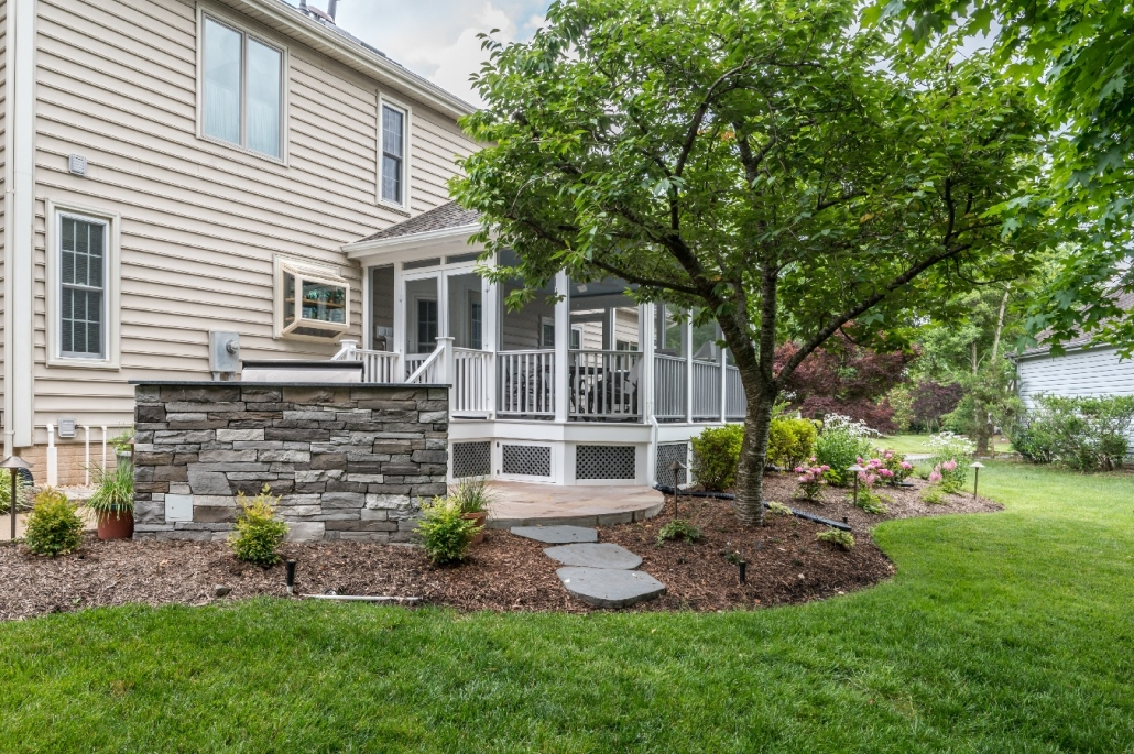 Custom grilling patio and screen porch addition in Centreville