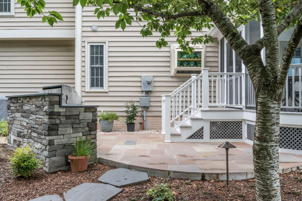New paver patio and grilling area with screen porch addition
