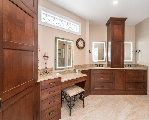 Spacious traditional master bath remodel with Alder wood cabinets in a burnt copper stain
