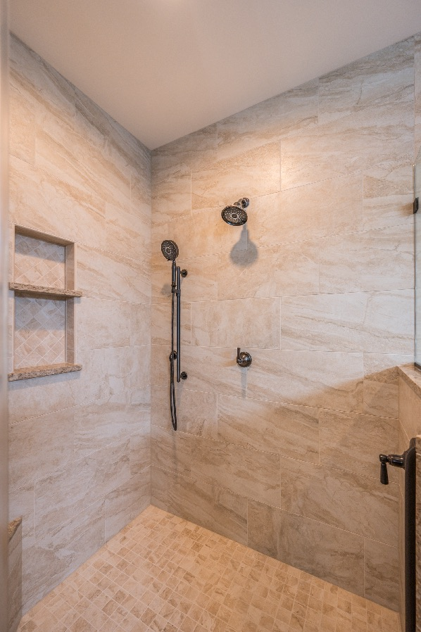 spacious shower enclosure bathroom remodel in Haymarket with light brown 12x24 tile