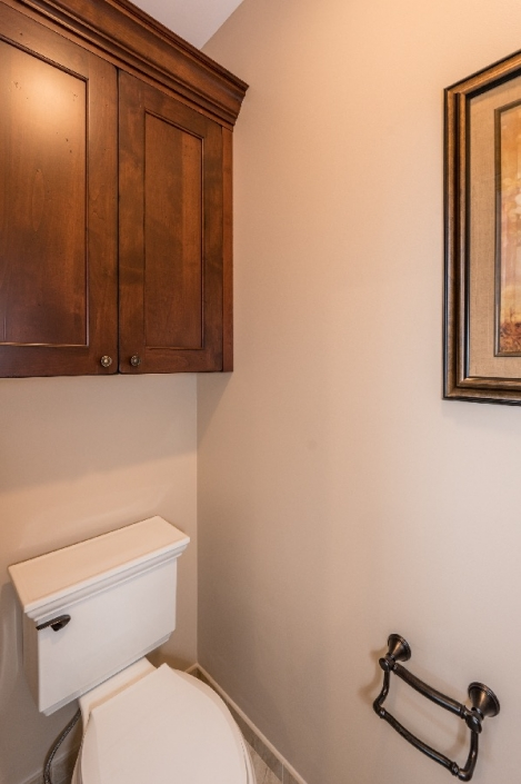 Master bath remodel toilet closet with custom alder cabinets and oil rubbed bronze fixtures
