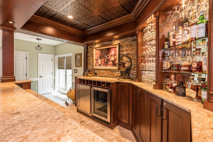 Custom bar design and build from Foster Remodeling with custom alder wood cabinets and Pewter/Tin Ceiling tiles