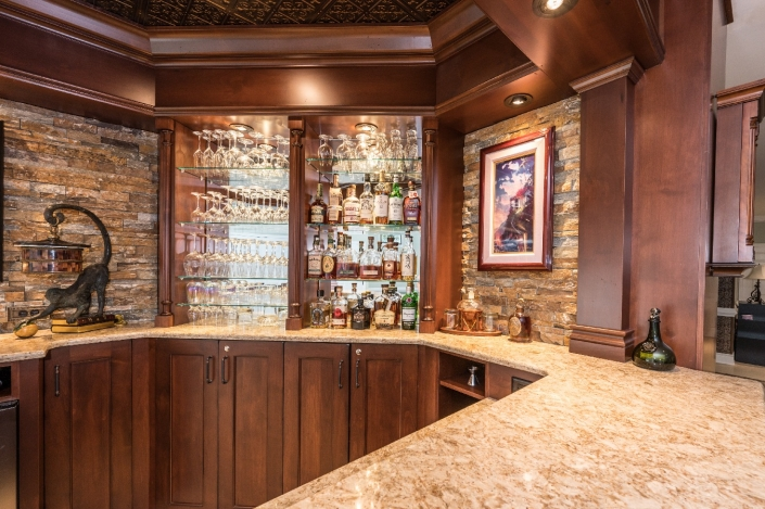 Custom bar design-build basement remodel with showcase lighting and quartz countertops