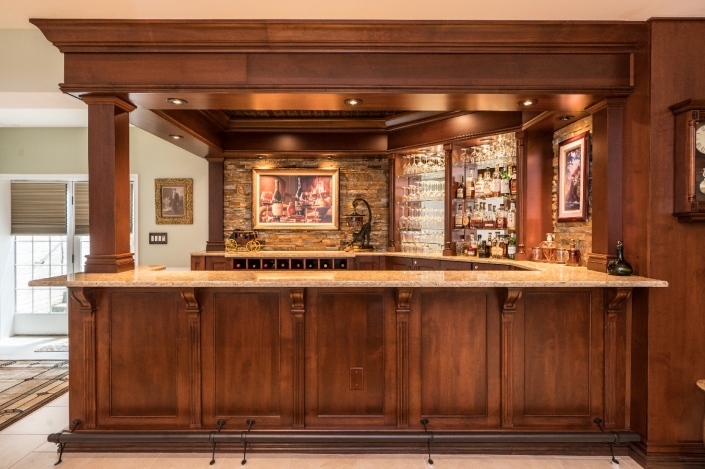 Luxury custom bar in basement remodel from Foster Remodeling