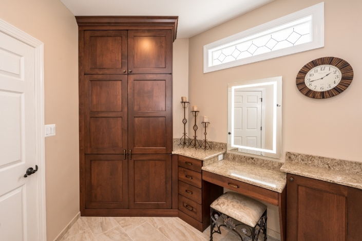 Foster remodeling master bath remodel with custom cabinets and a built in make up nook with LED lighted mirror