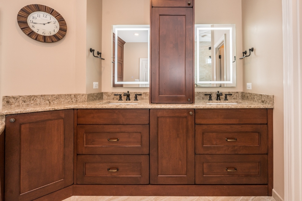 Master bath remodel with double vanity and custom cabinets for storage between sinks