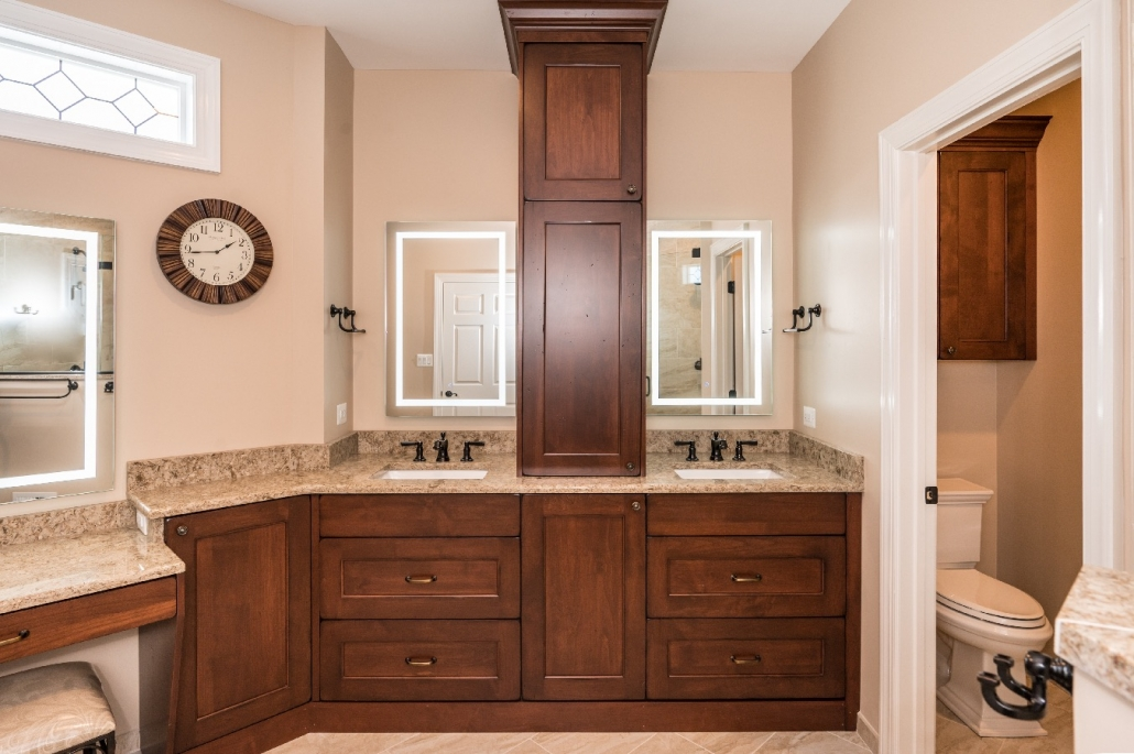 Spacious traditional master bath remodel in Haymarket, VA with Cambria countertops and lighted LED mirrors