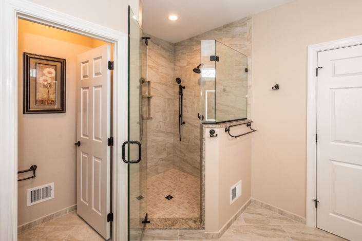 Master bathroom remodel in Haymarket, VA custom tile shower with frameless glass enclousure