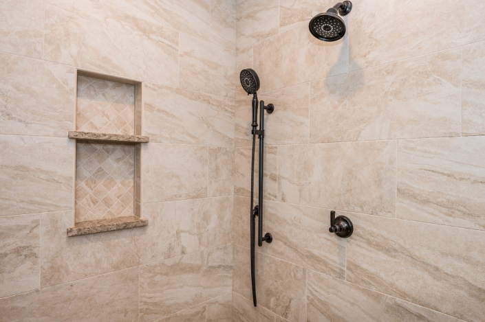 Haymarket master bathroom remodel with tile walls and custom niches