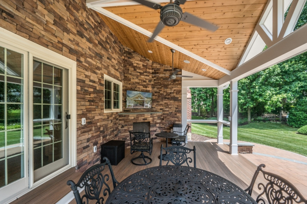 Springfield outdoor patio addition with warm brick and TV area