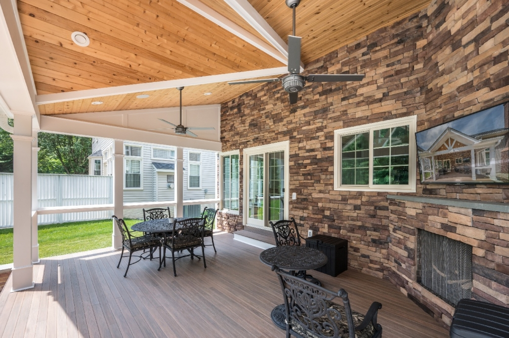 Springfield addition, outdoor patio with fireplace and TV area