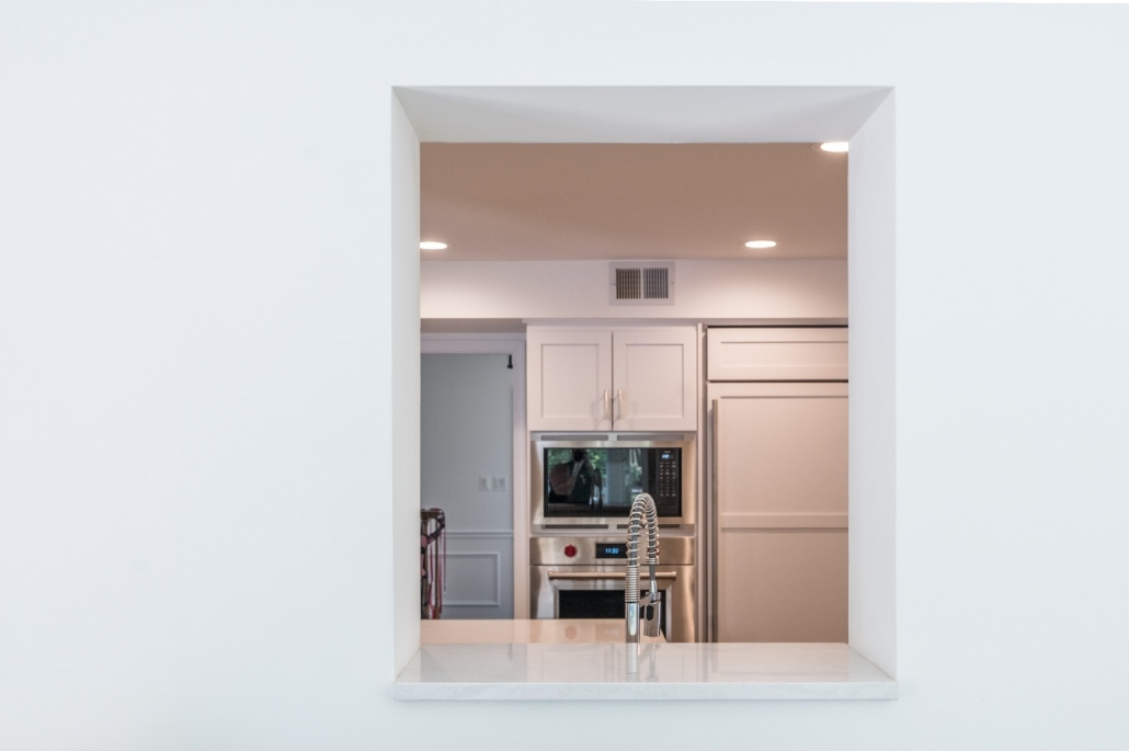 kitchen remodel custom pass through window with Cambria sill