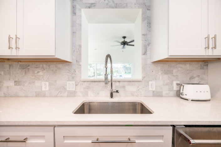 Alexandria, VA kitchen remodel with Cambria countertops and Moen single handle pull out spray faucet