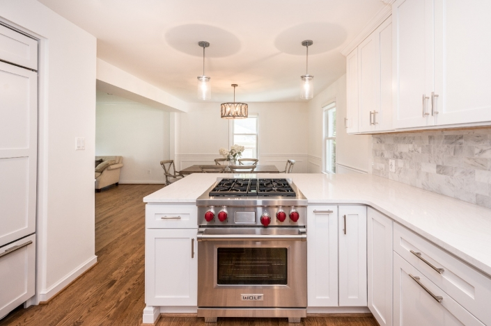 Modern Alexandria kitchen remodel with Crystal cabinets, Wolf Range and Cambria countertops