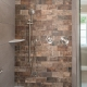 Custom master bath remodel with accent brick wall in shower stall and Moen fixtures