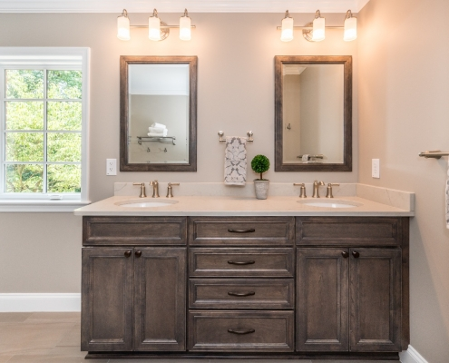 Traditional remodel master suite Alexandria VA with Koch cabinets and Moen Dartmoor faucets