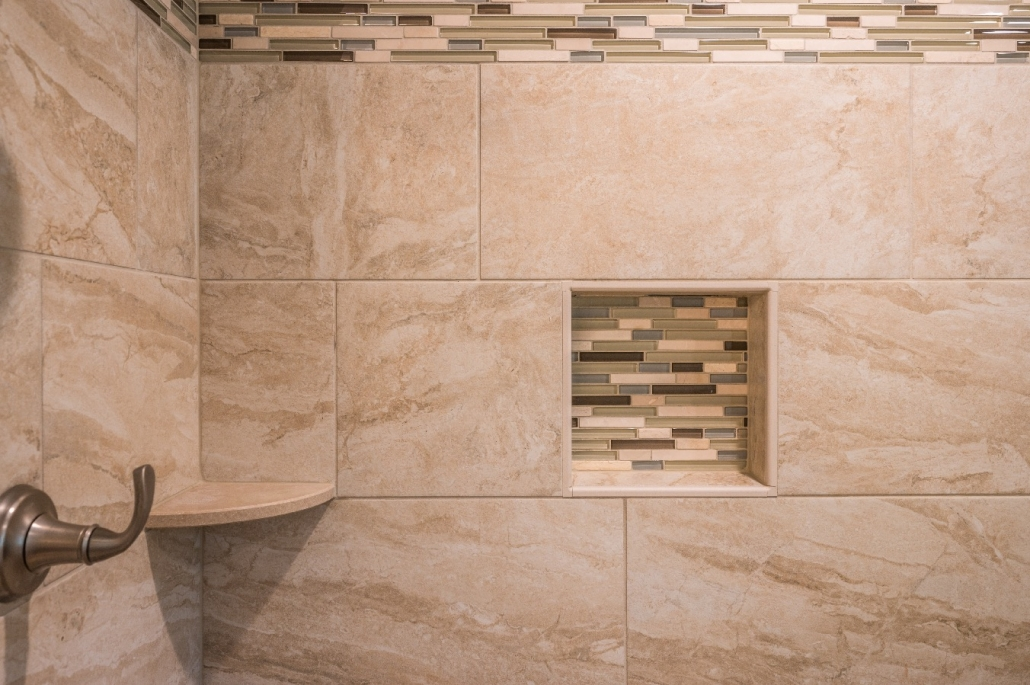Glass tile accents in shower stall of transitional Fairfax Station bathroom remodel