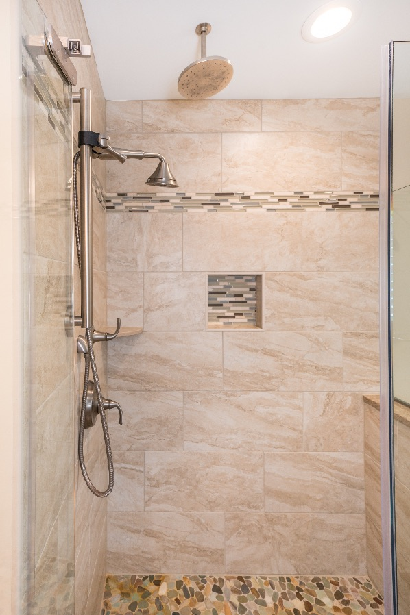 custom shower remodel fairfax station with recessed niche and pebble floor