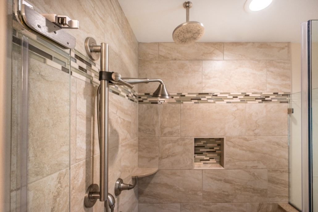 fairfax station bathroom remodel features Kohler Forte shower fixture Ivory tile shower walls