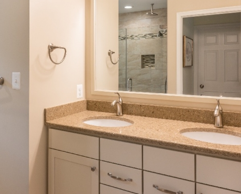 floating vanity with under cabinet lighting and Silestone vanity top