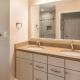floating vanity with under cabinet lighting and Silestone vanity top