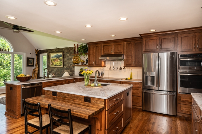 Falls Church kitchen remodel featuring custom island with butcher block made of Shedua wood and brushed bronze cabinet pulls