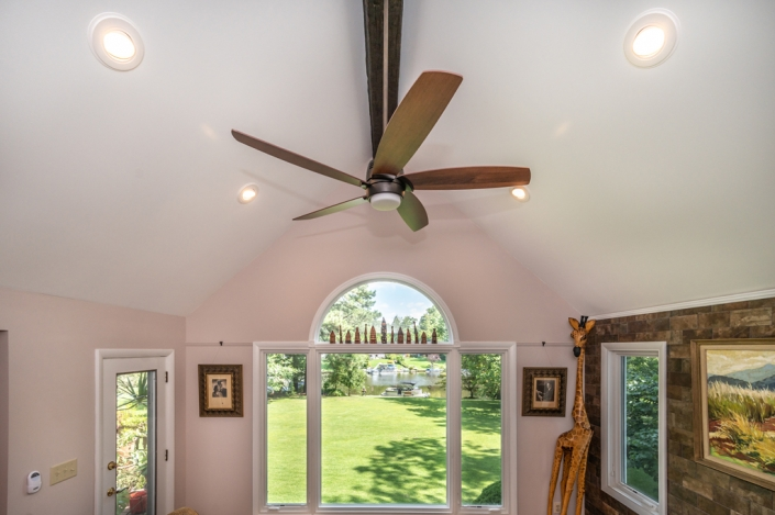 Falls Church, VA kitchen and family room remodel featuring custom windows and faux wood beam with ceiling fan