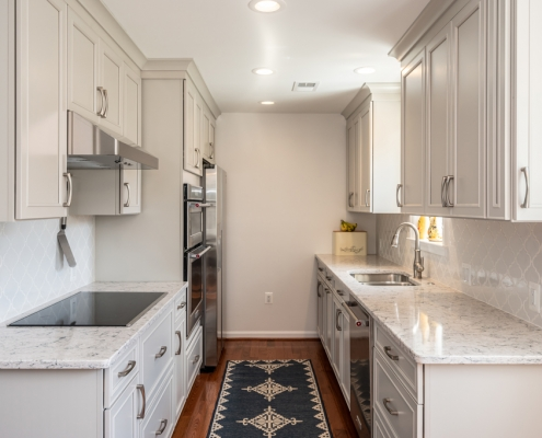 Alexandria kitchen remodel galley style with Waypoint cabinets in Harbor color and Silestone countertops
