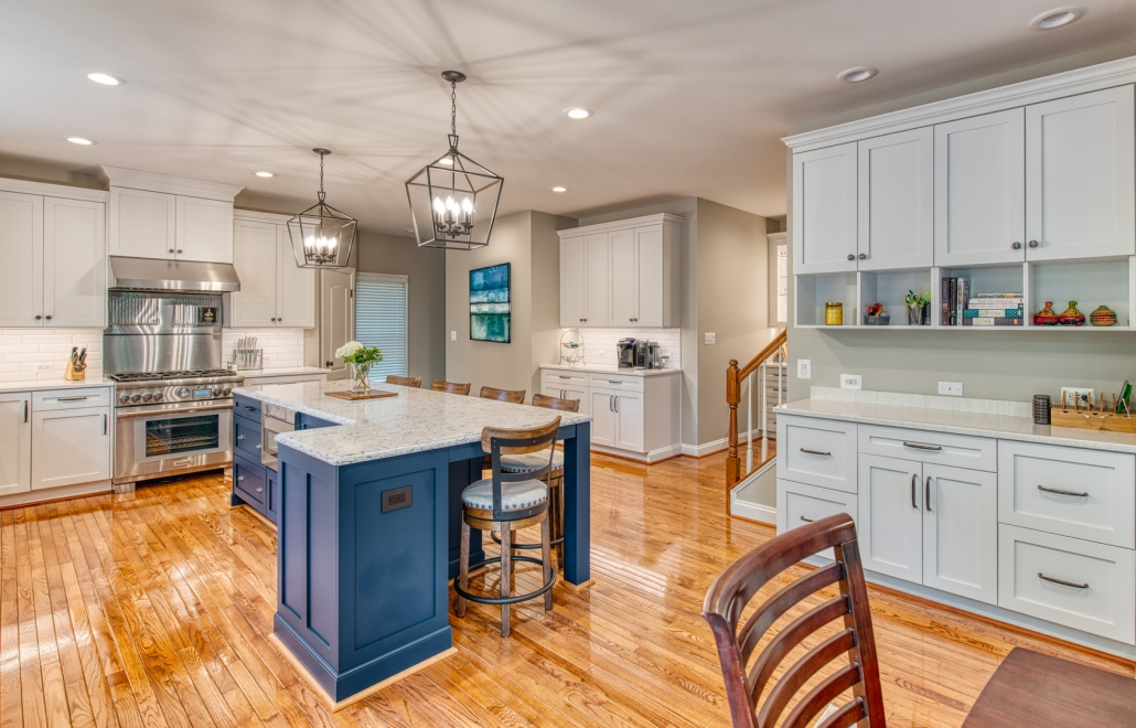 Kitchen remodel in Vienna, VA with custom cabinets with ample storage and large blue island