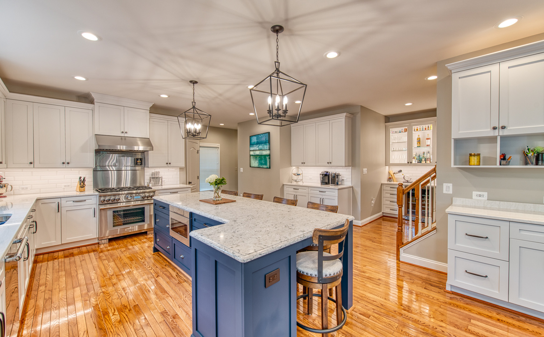 Large kitchen remodel in Vienna, VA with many cabinets and hardwood flooring