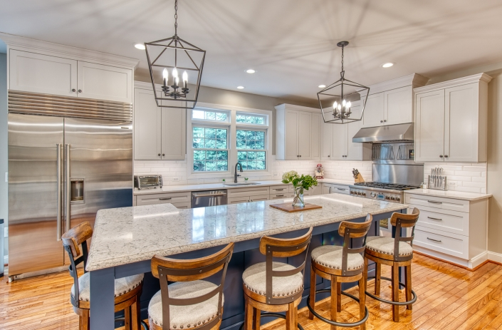 Custom kitchen remodel in Vienna, VA with nautical blue island and white cabinets