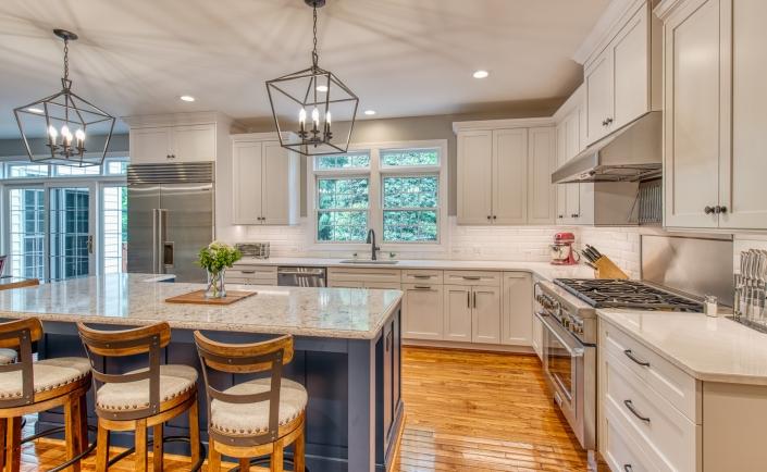 Custom kitchen remodel in Vienna, VA with nautical blue island and white Crystal cabinets