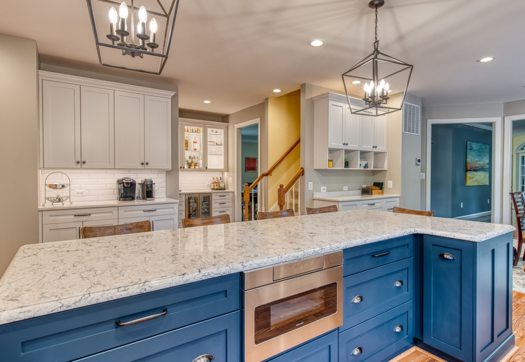 Vienna, VA, custom kitchen remodel with nautical blue Crystal cabinets and geometric light fixtures