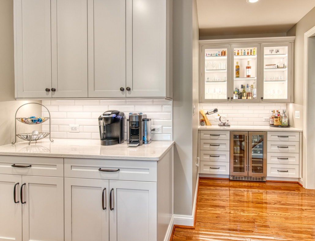 Custom Vienna kitchen remodel with white Crystal Current cabinets and hardwood floor
