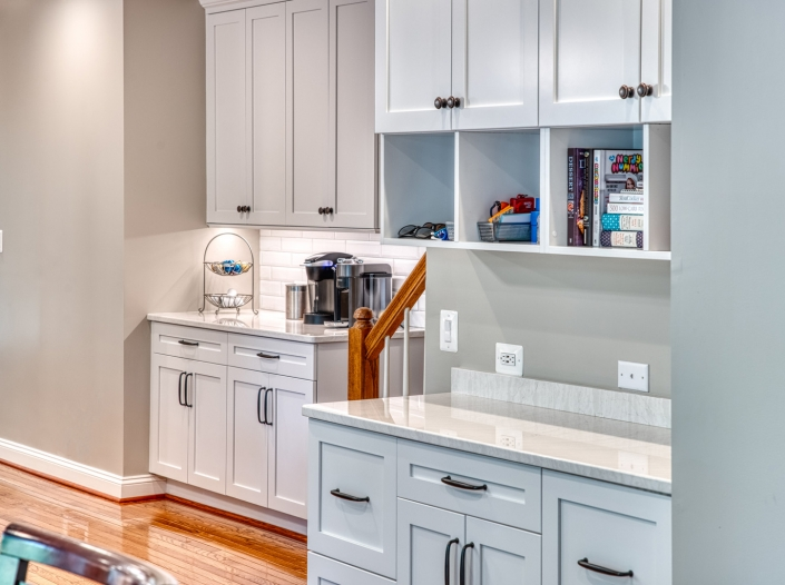 Custom cabinetry in Vienna Kitchen remodel with inset drawer and door style and subway tile backsplash