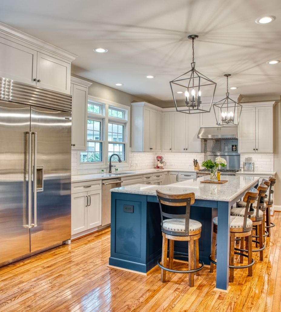 Vienna kitchen remodel with geometric lighting and Navy blue custom island