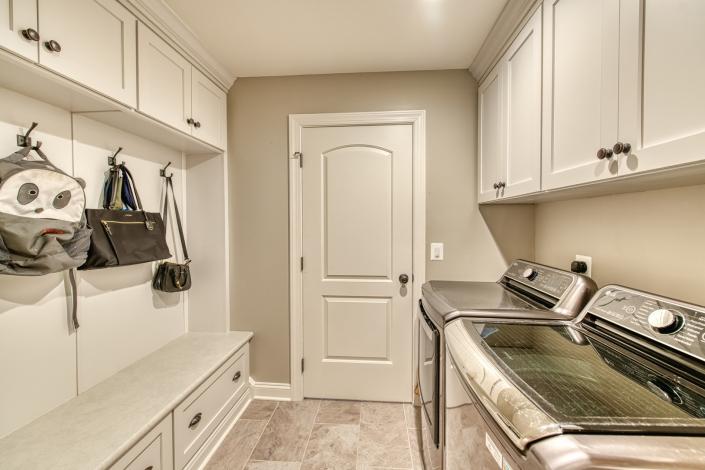 Vienna laundry room remodel with bench seating and storage