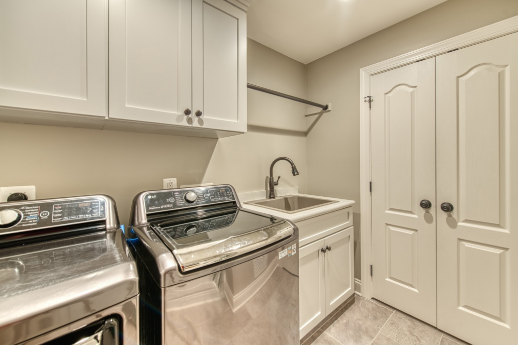 Vienna laundry room remodel with crystal cabinets