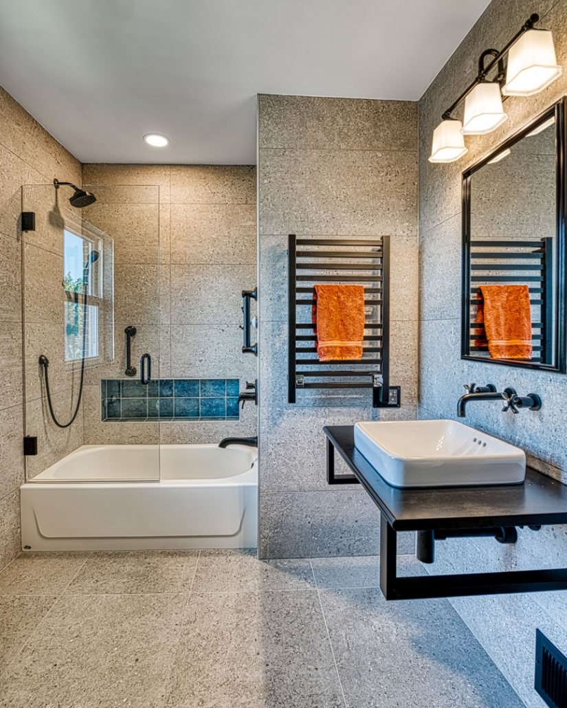 Arlington Bath remodel Industrial chic with metal features and stone walls