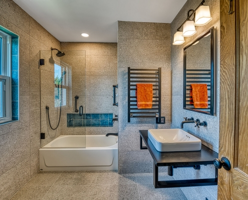 Custom Bath remodeling Arlington VA with oil rubbed bronze fixtures and a towel warmer
