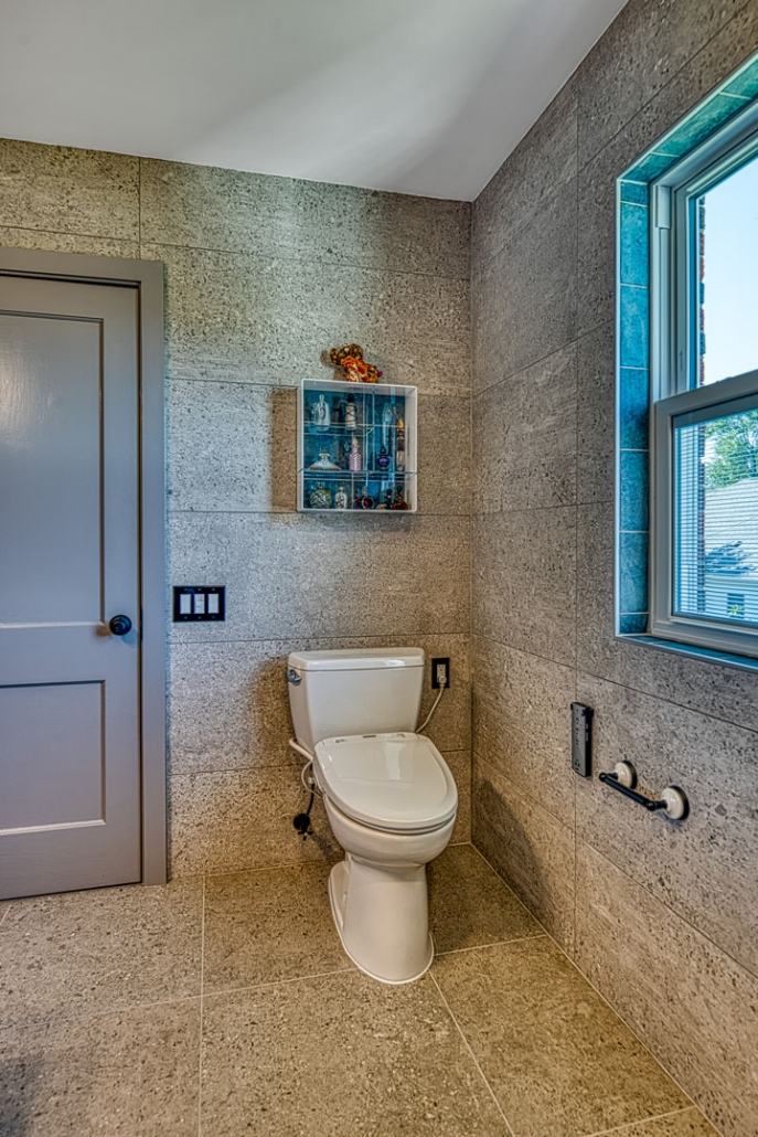 Bathroom remodel Arlington VA with stone tile and comfort height toilet with built in bidet