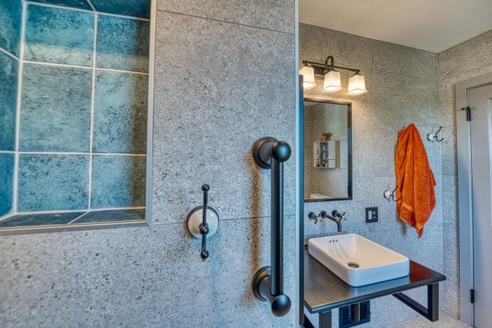 Arlington bathroom remodel with custom built in niche and grab bars