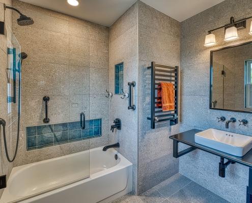 Arlington bathroom remodel with sleek Industrial chic fixtures and floating sink