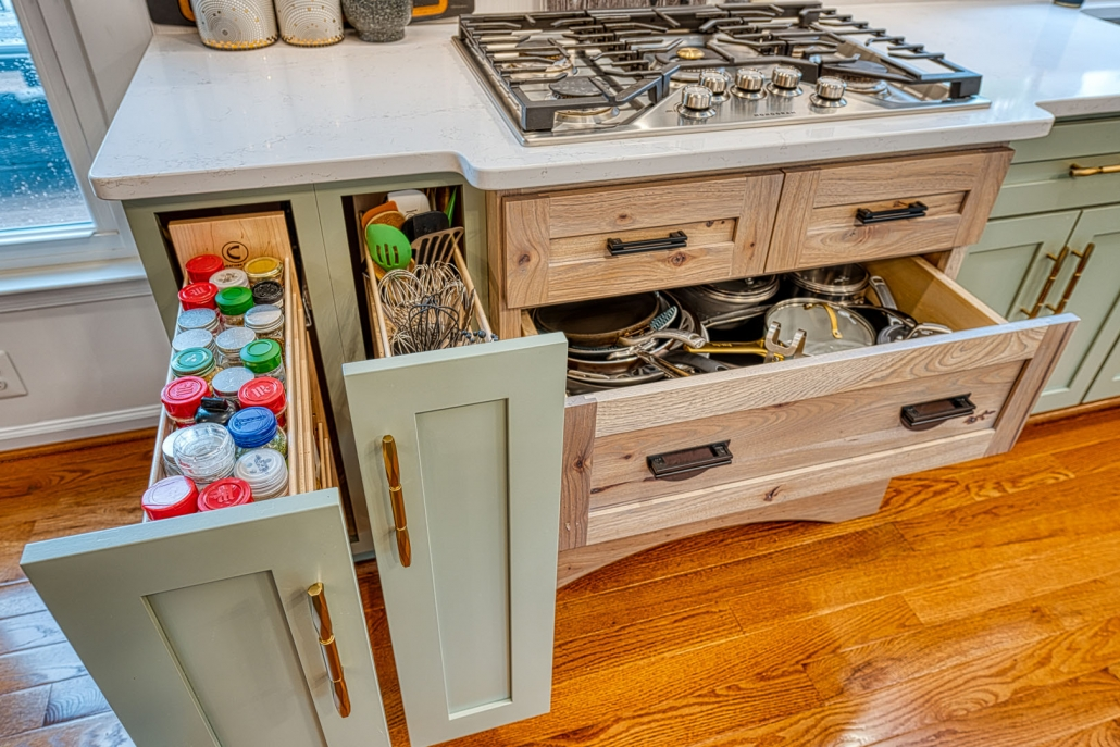 Gainesville, VA kitchen remodel with sage green custom cabinets with pull outs for spices and utensils