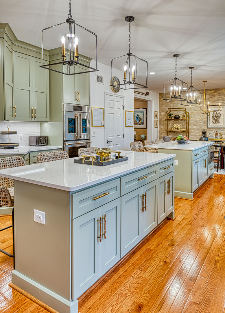 Kitchen remodeling Gainesville VA with sage green double eat in islands and custom light fixtures