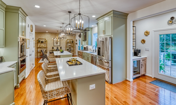 Rustic Modern kitchen remodeling in Gainesville VA with double eat in islands and custom stone feature wall