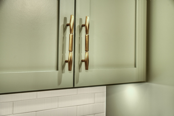 Kitchen remodeling Gainesville VA close up of sage green cabinets with gold hardware
