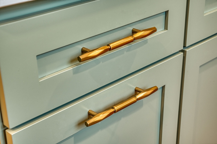 Gainesville kitchen remodel close up of cabinet drawer with gold drawer pulls