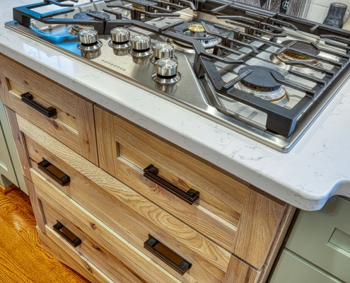 Kitchen Remodeling Gainesville VA custom cooktop with stained furniture like cabinet underneath