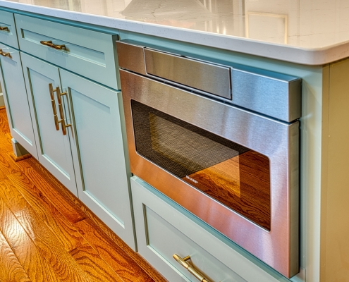 Gainesville VA kitchen remodel with pull down microwave in island